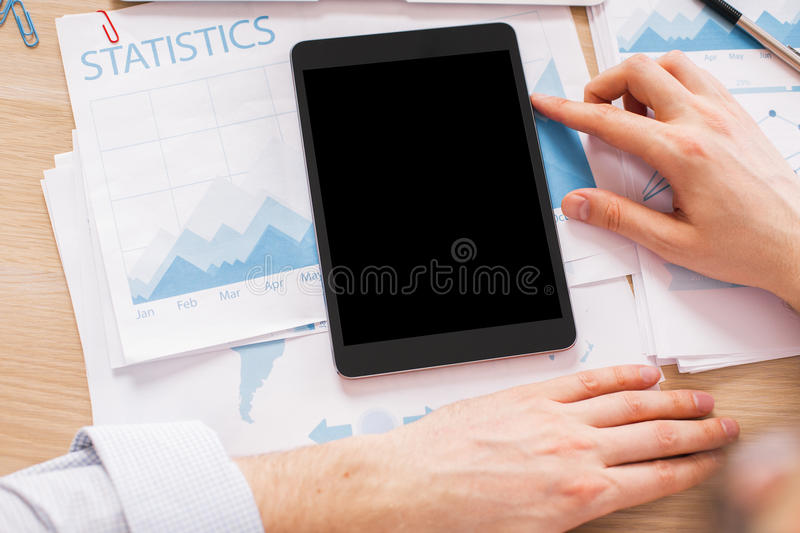 Male hands black tablet royalty free stock photography