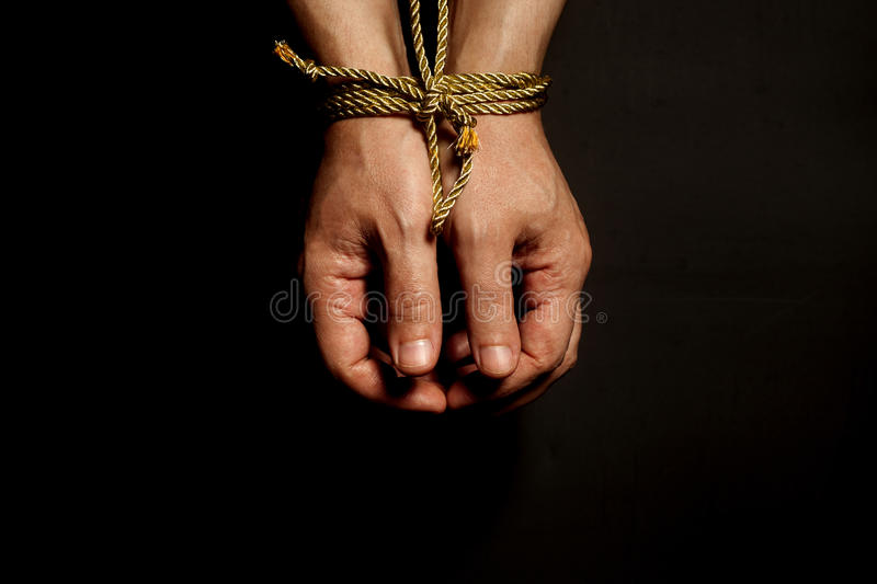 Male hands bound with rope. Addiction concept stock photos