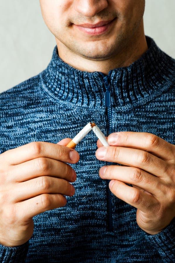 Download Male Hands Breaks Cigarette Stock Image - Image of cigarette, male: 26522583