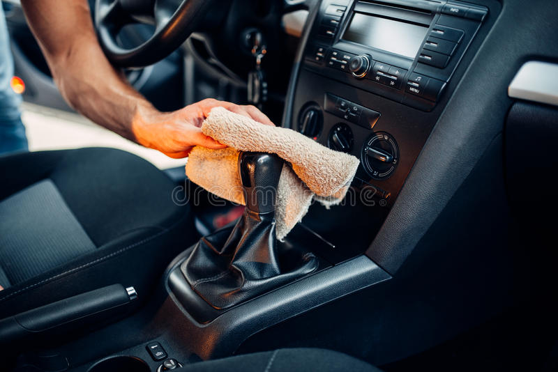 Male hands cleans car interior on carwash station. Automobile cleaning royalty free stock image
