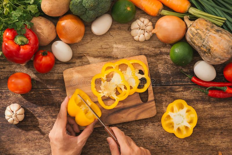 Male hands cooking vegetables salad in kitchen. Top view. royalty free stock photos