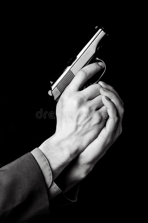 Male hands with gun
