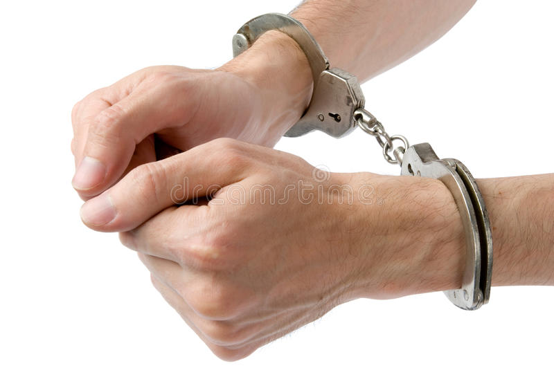 Male hands in handcuffs stock photo