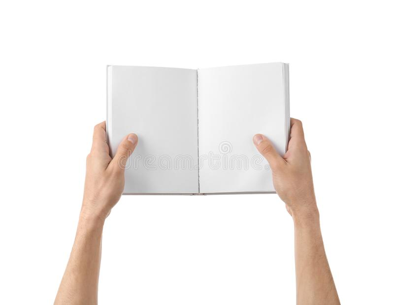Male hands holding book with blank pages on white background stock images