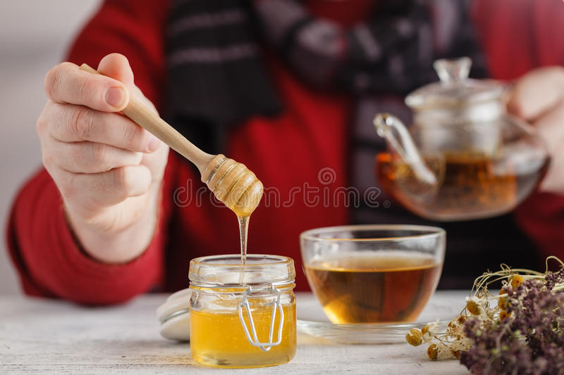 Male hands holding cup with hot herbal tea. Winter and Christmas stock photo