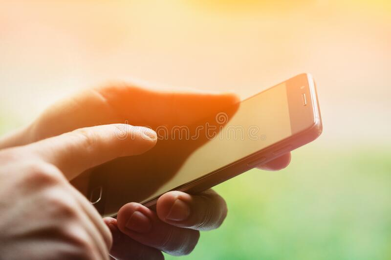 Male hands holding mobile phone, pointing finger on smartphone screen royalty free stock photography