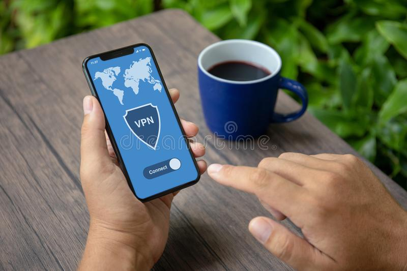 Male hands holding phone with app vpn creation Internet protocol stock photos