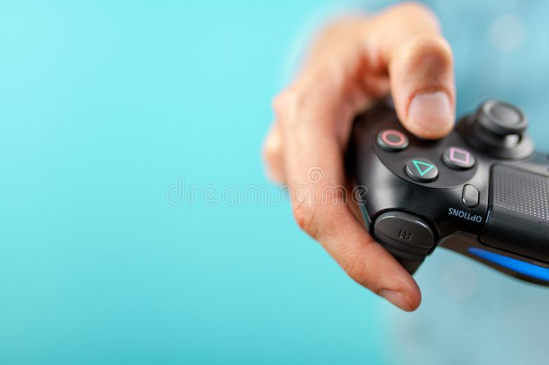 Male hands holding a PS4 controller royalty free stock photo