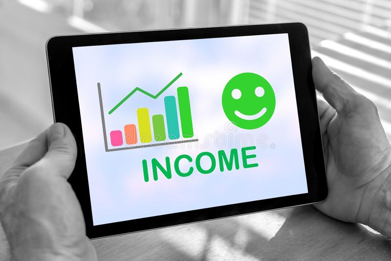 Income growth concept on a tablet. Male hands holding a tablet with income growth concept royalty free stock images