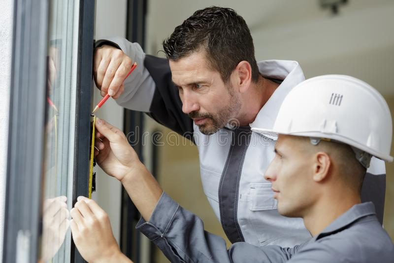Male hands making window measurements. Measuring royalty free stock photos