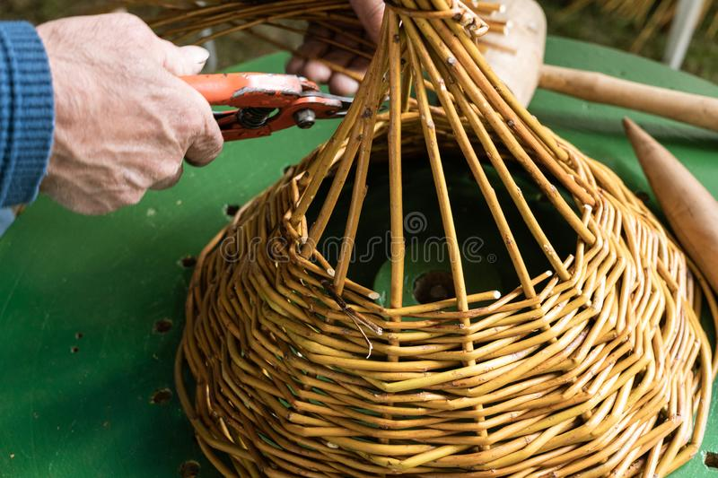 Male hands Manufacturing Wickerwork basket. Handcraft concept royalty free stock photo
