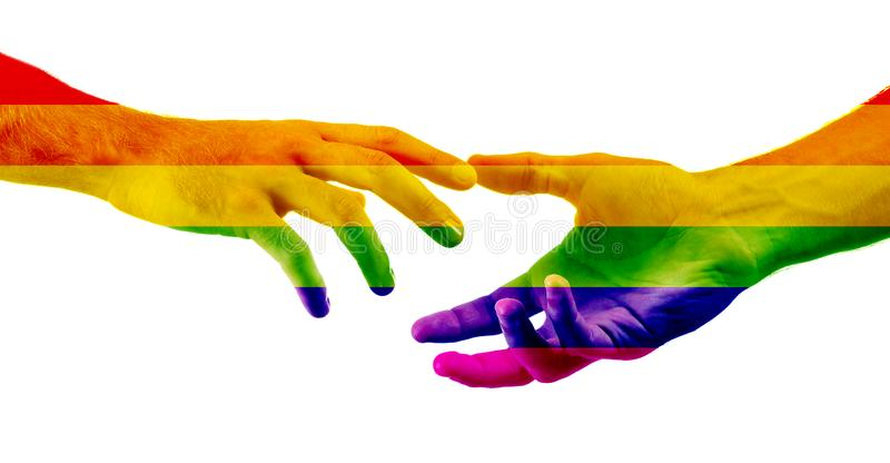 Male hands painted as the rainbow flag reaching out to each other on white background. LGBT concept stock photos