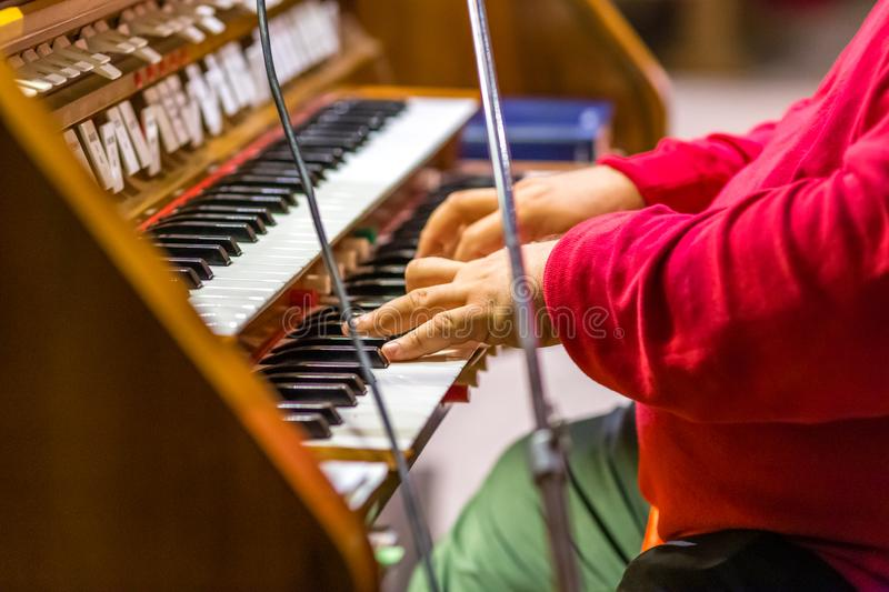 Hands playing organ keyboard royalty free stock photography