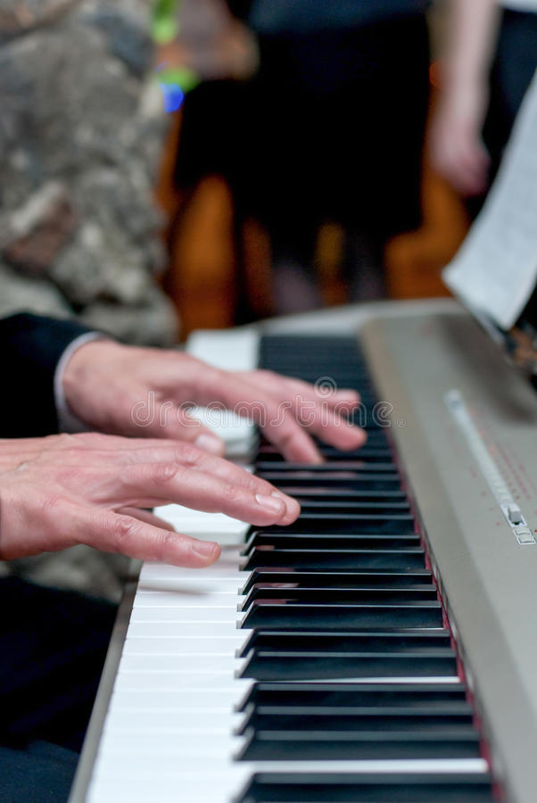 Male hands playing the piano, press the keys, music concept royalty free stock image