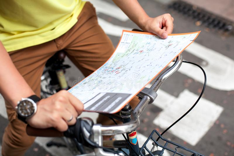 Male hands pointing on the map of Barcelona city on retro bicycle bike background.Tourism concept. Vacation.Holiday stock image