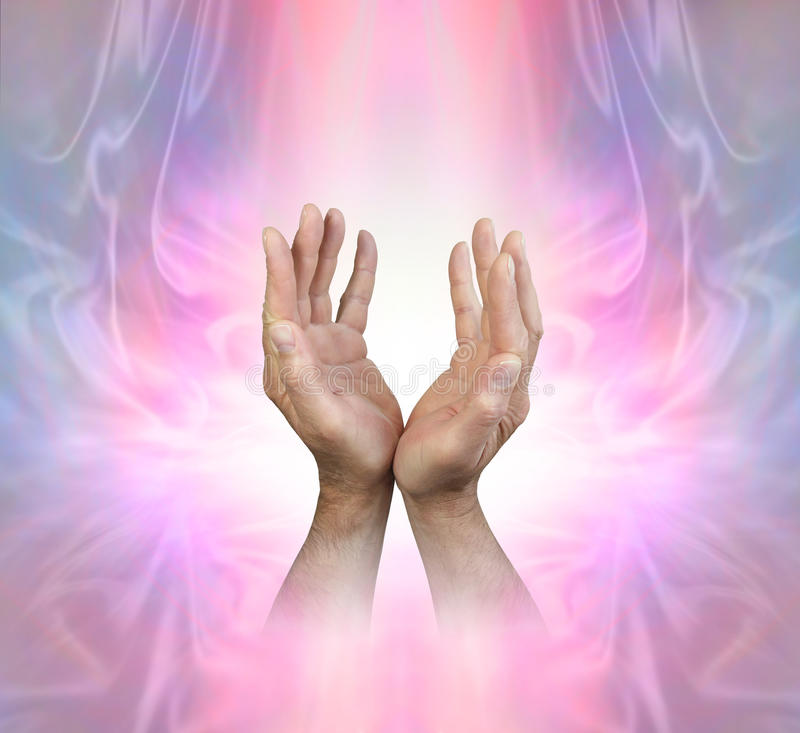 Male hands sensing Feminine Energy Field. Male hands reaching up into a pink stream of light on a beautiful ethereal Angelic energy background with copy space royalty free stock image