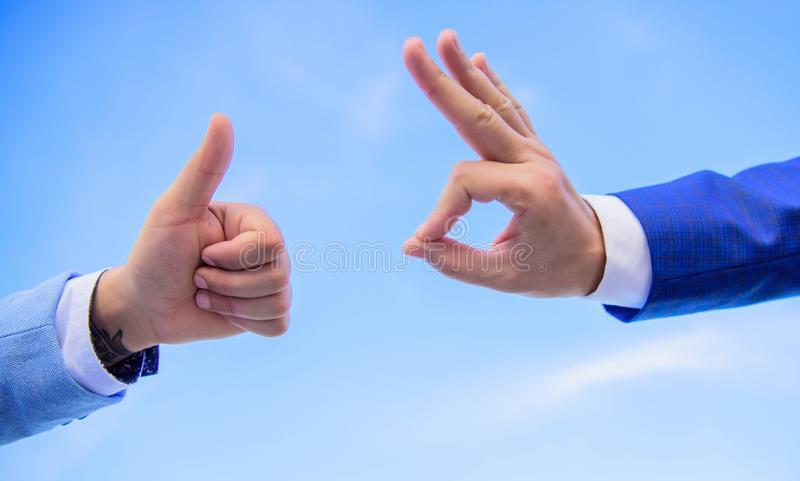 Male hands show thumbs up sign. Success and approval concept. Gesture expresses approval. Business approval and royalty free stock photography