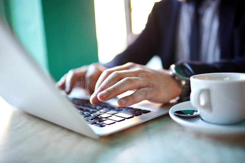 Male Hands Typing at Laptop royalty free stock photos