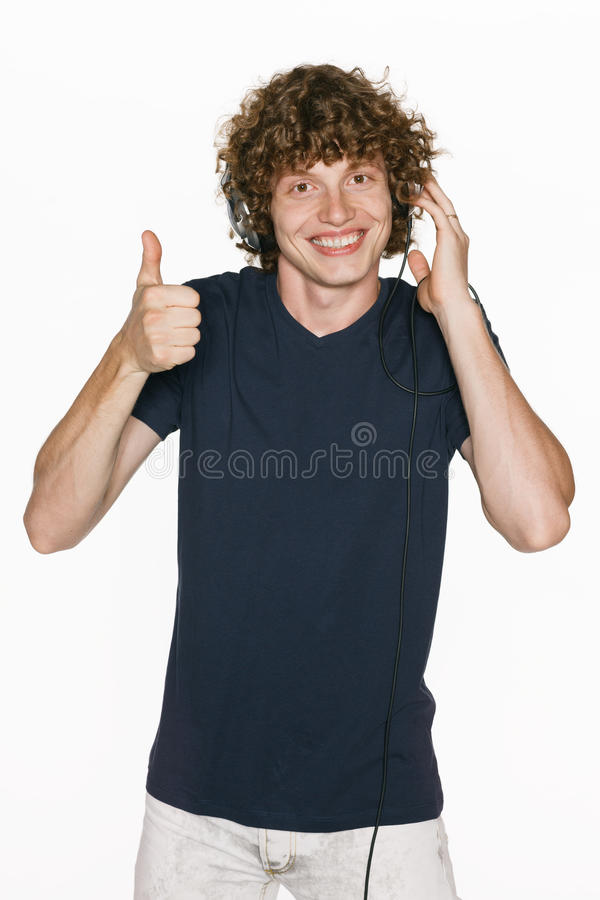 Male In Headphones Gesturing Thumb Up Stock Photography
