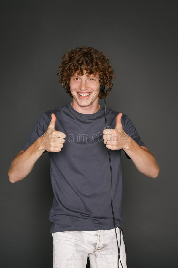 Download Male In Headphones Gesturing Thumb Ups Stock Image - Image: 34724273