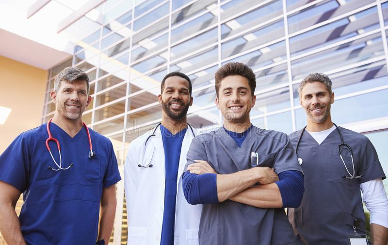 Male healthcare colleagues standing outdoors, low angle stock image