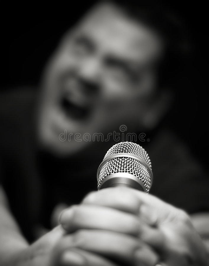 Download Male Heavy Metal Singer Screams Into Microphone Stock Image - Image: 7654335