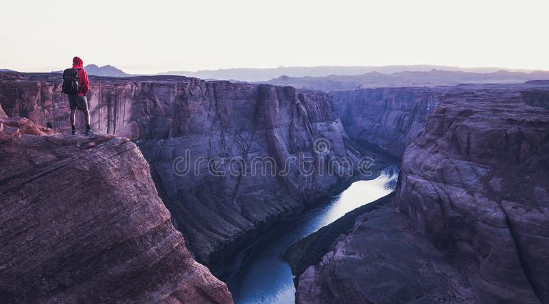 Male hiker overlooking Horseshoe Bend in twilight, Arizona, USA royalty free stock photography