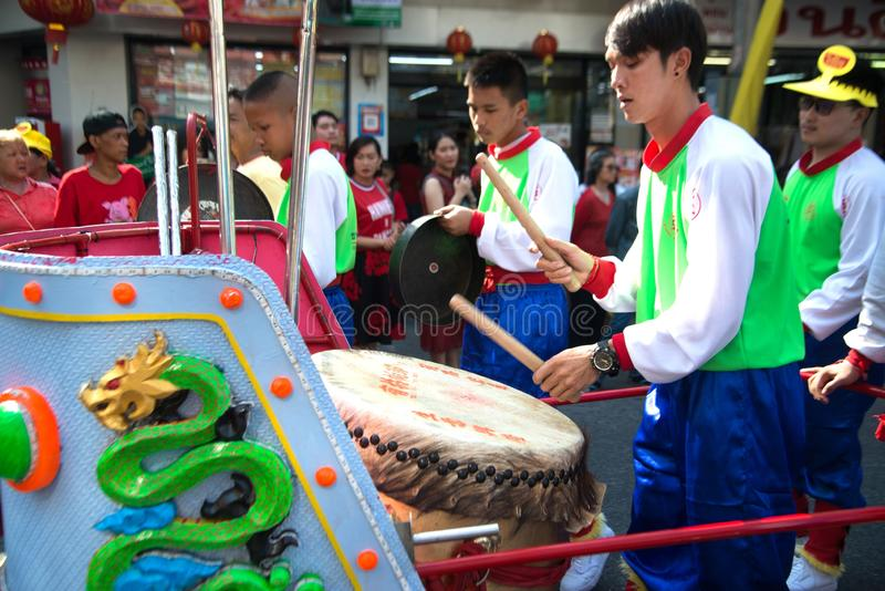 Male hitting drum in parade show in Chinese New Year celebration in Thailand. stock photos