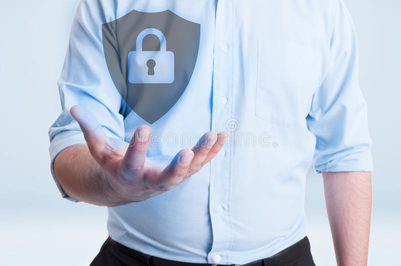 Male holding futuristic hologram with locked shield stock photography