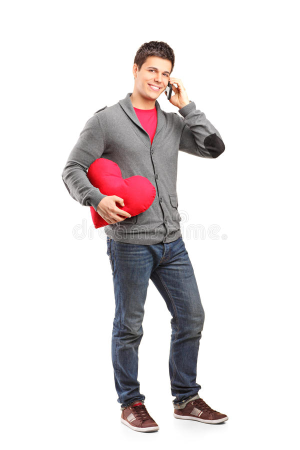Download Male Holding A Heart Shaped Pillow Stock Image - Image: 26301071