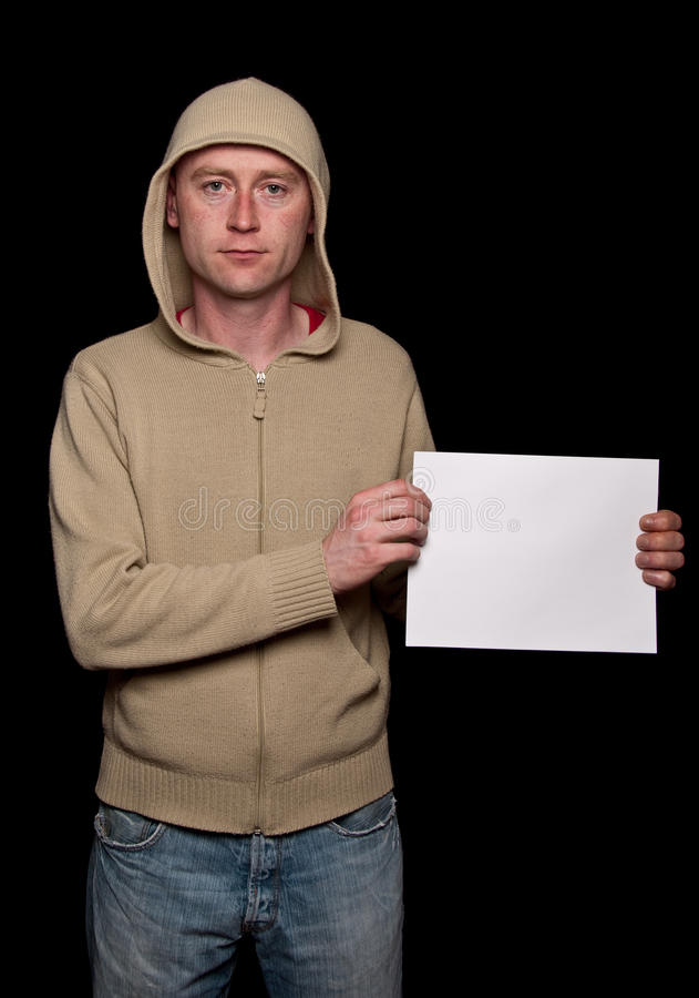 Male in a hoodie holding blank advert space royalty free stock image