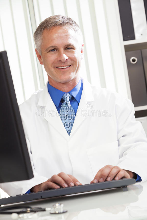 Male Hospital Doctor Using Computer Stock Image