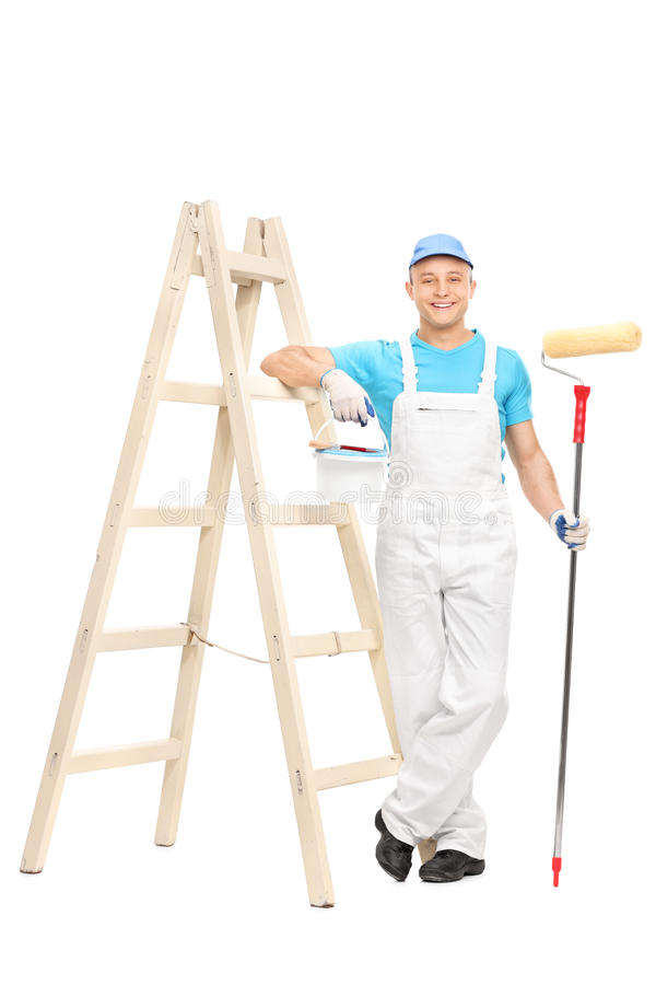 Male house painter holding a paint roller stock photo