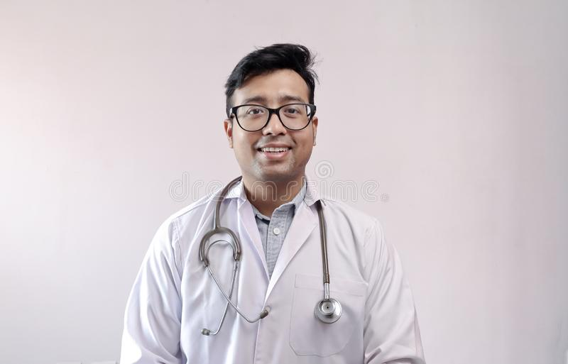 Male indian doctor in white coat and stethoscope stock photography