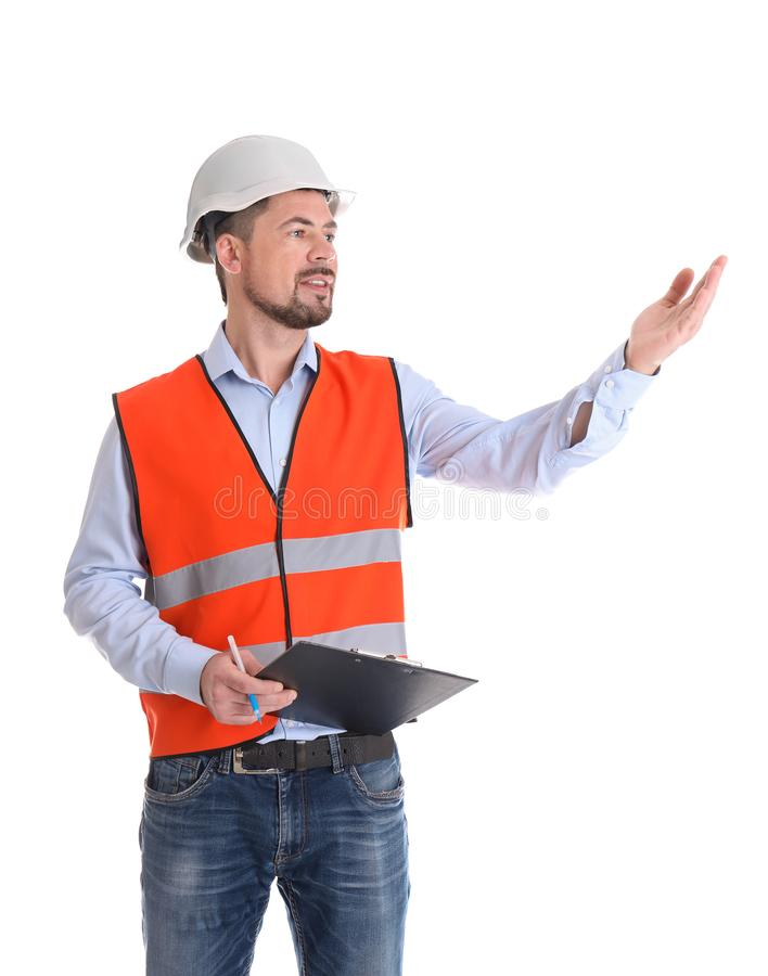 Male industrial engineer in uniform with clipboard on white background. Safety equipment royalty free stock photography
