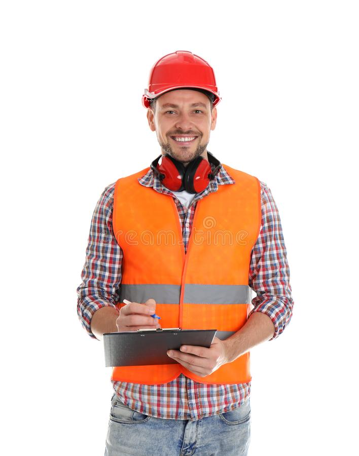 Male industrial engineer in uniform with clipboard on white background. Safety equipment stock photos