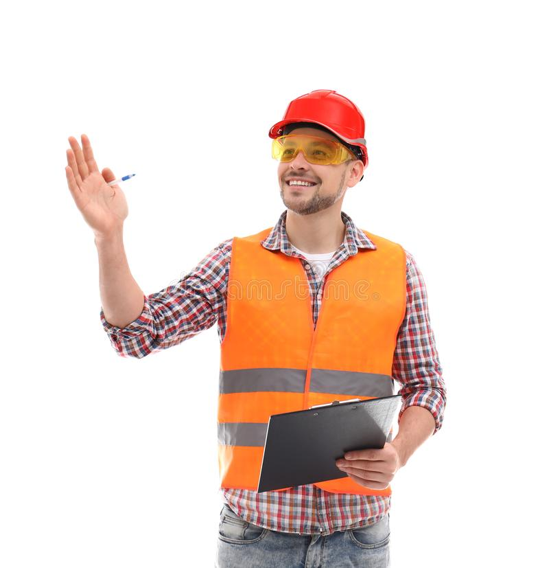 Male industrial engineer in uniform with clipboard on white background. Safety equipment stock images