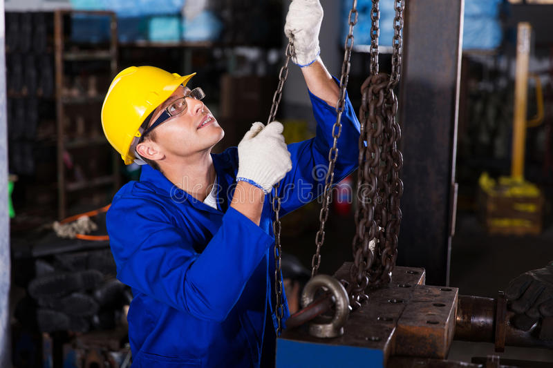 Male industrial worker. Skilled male industrial worker at work stock photo