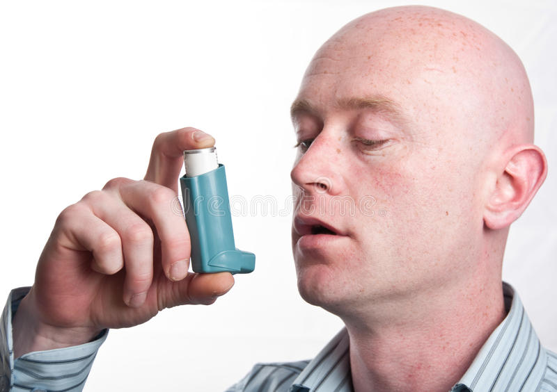Male with inhaler on white backdrop stock image