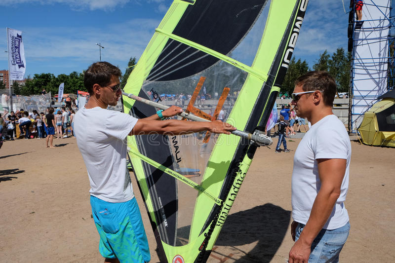 Male instructor shows how to manage Windsurfing at the beach stock photos