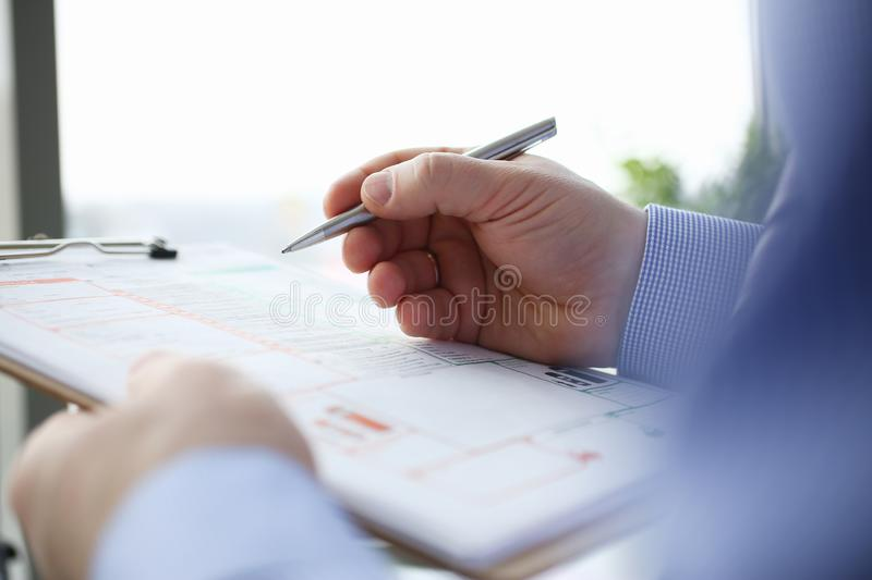 Male insurer hand hold silver pen an accident stock image