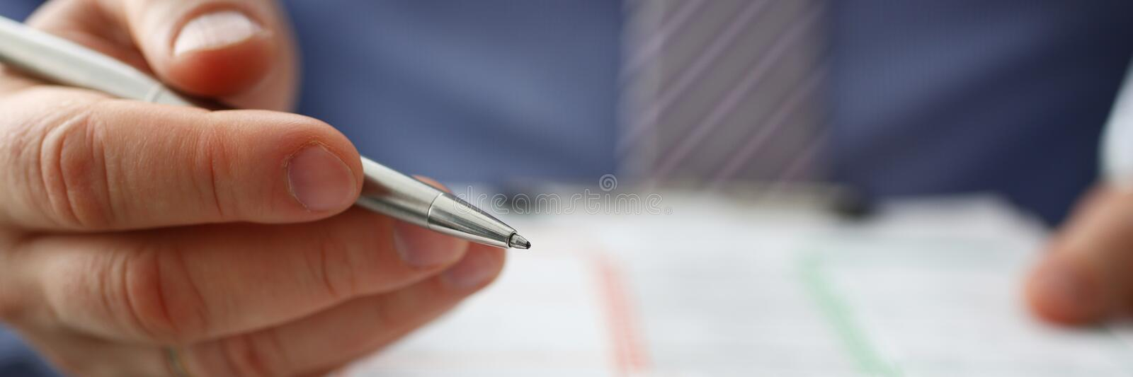 Male insurer hand hold silver pen an accident stock photos