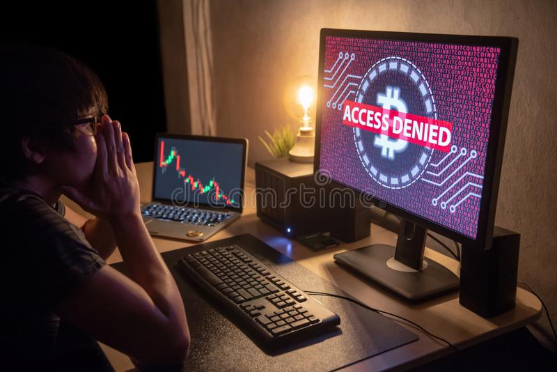 Male Investor feeling stressed due to access denied of bitcoin s. Male Investor feeling stressed and frustrated due to access denied of bitcoin system with royalty free stock photography