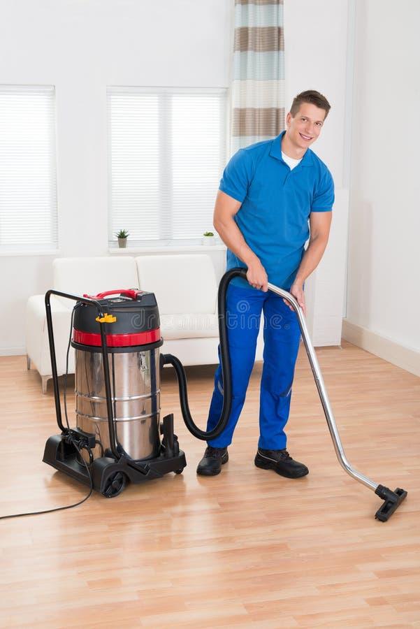 Male Janitor Vacuuming Floor Stock Image Image Of Maintenance