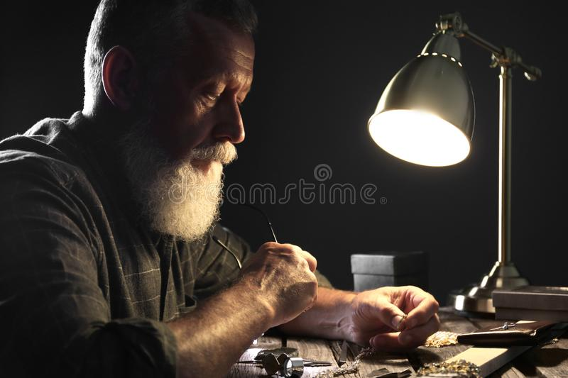 Male jeweler with precious gemstones royalty free stock photo