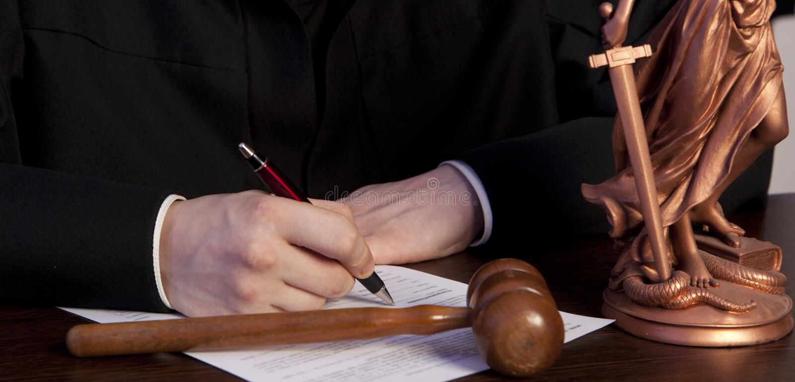 Male judge in a courtroom striking the gavel royalty free stock photo