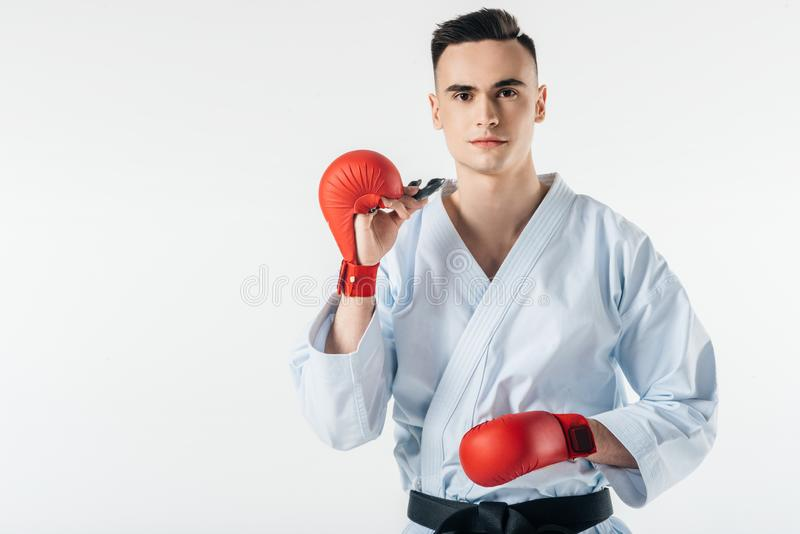 Male karate fighter with mouthguard. Isolated on white royalty free stock image
