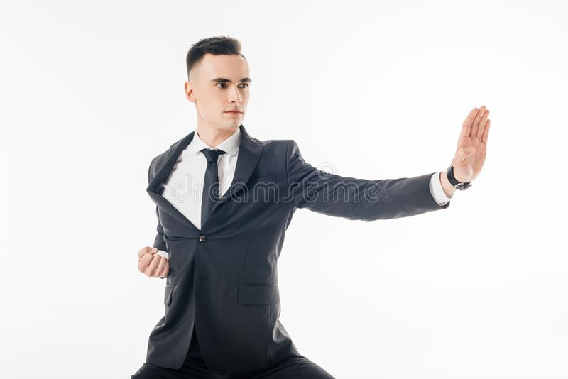 Male karate fighter standing in position in suit. Isolated on white stock images