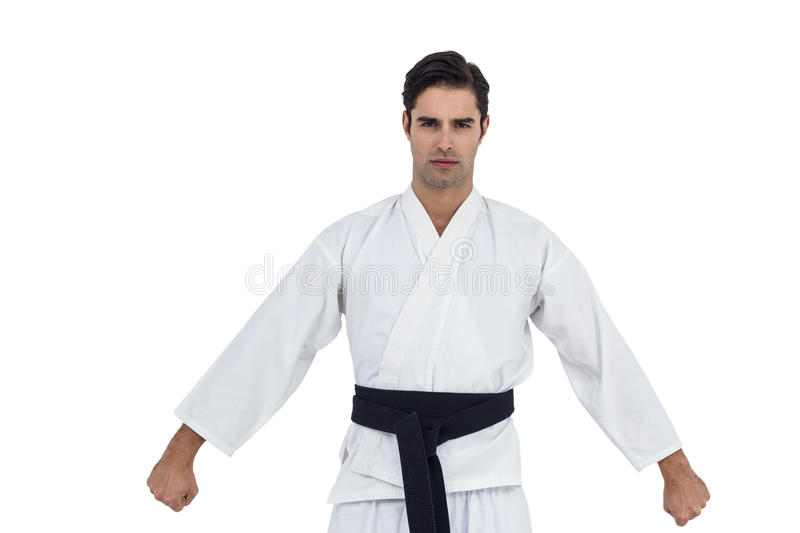 Male karate player posing on white background stock photo