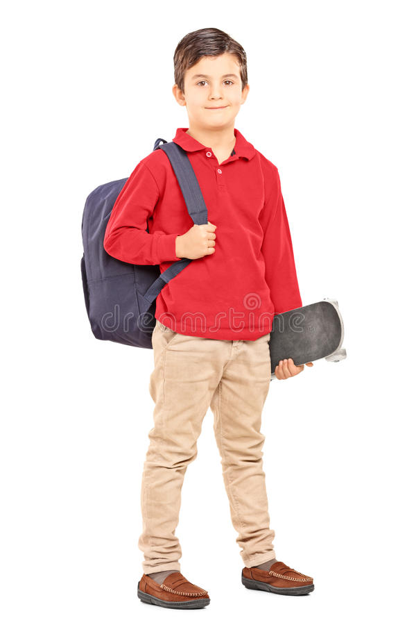 Male kid with backpack and skateboard isolated on white background royalty free stock photography